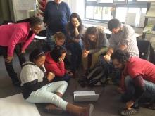 groups crowds around laptop